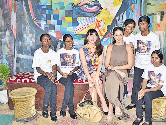 Miss Universe Great Britain Jaime-Lee Faulkner at the cafe run by acid attack survivors in Agra.