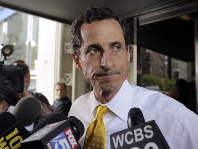 Former Congressman Anthony Weiner leaves his apartment building in New York.