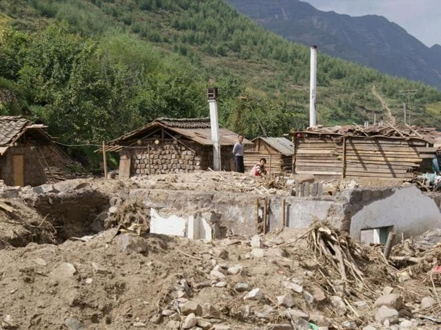 This handout photo by Unicef DPRK shows heavily damaged homes due to heavy flooding of the Tumen river in Haksan Ri, North Korea.