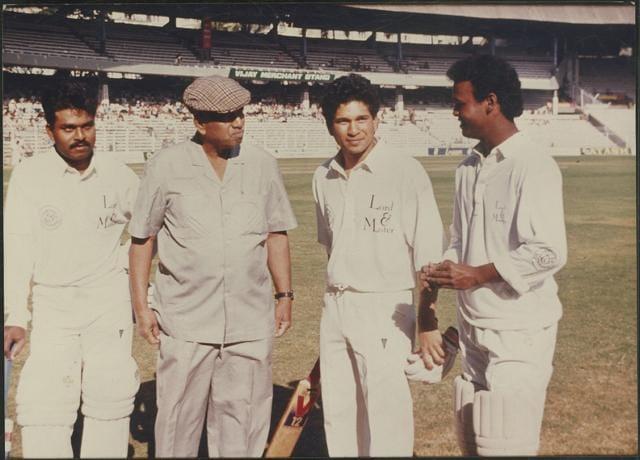 Pravin Amre, coach Ramakant Achrekar, Sachin Tendulkar, and Vinod Kambli at Wankhede Stadium in Mumbai in the early 1990s. In Aravind Adiga's Selection Day, Mohan Kumar travels to Mumbai, convinced that his sons, Radha and Manju, could become the world's best batsmen.