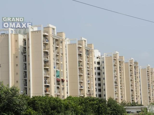 The Noida authority said registry of these flats will be executed only after the builder deposits dues of around Rs 200 crore.