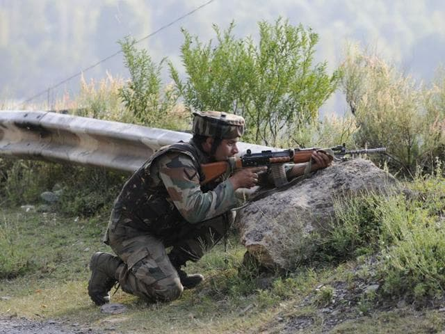 A soldier near the army base which was attacked in Uri on Sunday. Islamabad has denied any role in the attack that left 18 soldiers dead.