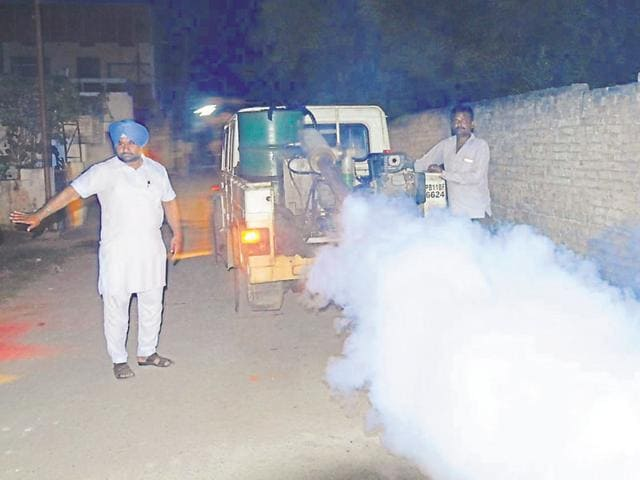 The municipal corporation employees fogging an area in Patiala on Thursday.