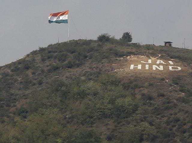 The Indian flag flies on a hill in Uri sector, near the de facto border dividing Kashmir between India and Pakistan, on September 21, 2016.