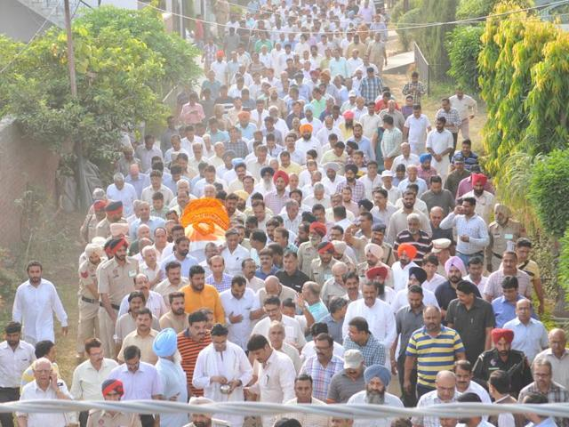People throng the funeral procession of Jagdish Gagneja in Jalandhar on Thursday.
