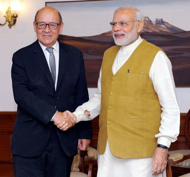 French defence minister Jean Yves Le Drian with Prime Minister Narendra Modi in New Delhi on September 23, 2016.