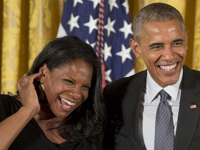 President Barack Obama shares a laugh with actress and singer Audra McDonald before presenting her with the 2015 National Medal of Arts during a ceremony in the East Room of the White House in Washington on Thursday.