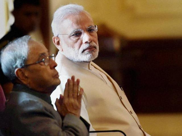 President Pranab Mukherjee releases vice-president Hamid Ansari's book 'Citizen and Society' in the presence of Prime Minister Narendra Modi at Rashtrapati Bhavan in New Delhi on Friday.