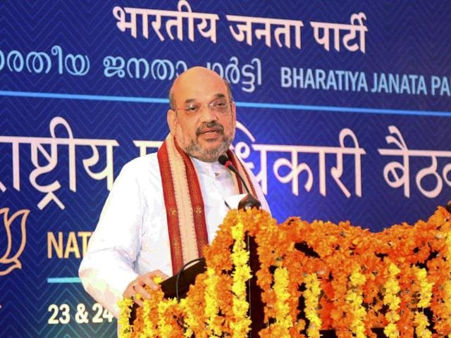 BJP National President Amit Shah speaks at the inauguration of the party's national council meeting in Kozhikode on Friday.