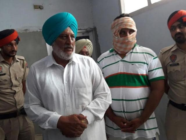 Akali leader Paramjeet Singh and his son Gurjeet Singh in police custody in Baghapurana, Moga, on Saturday.