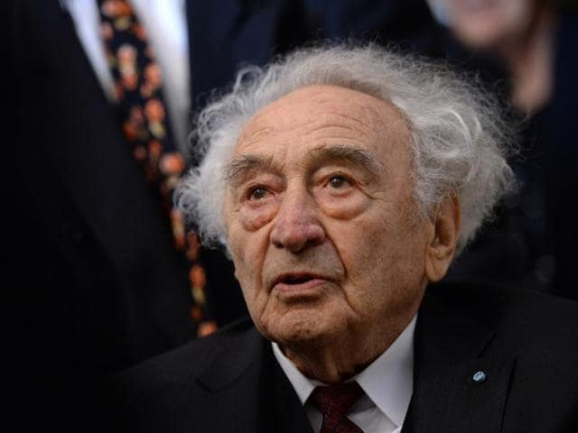 Holocaust survivor Max Mannheimer arrives for a ceremony marking the 70th anniversary of the Auschwitz concentration camp in Munich.