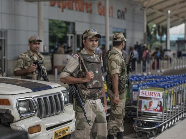 Members of the Central Industrial Security Force stand guard at the domestic airport in Mumbai on Friday.