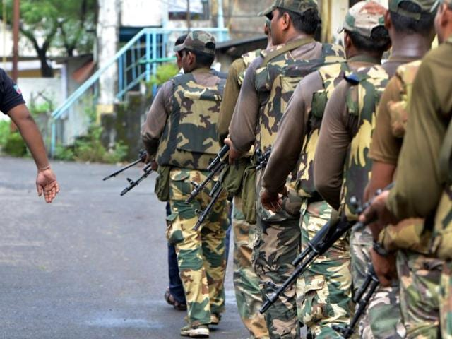 Police personnel conducting search operations at Uran in Navi Mumbai on Friday.