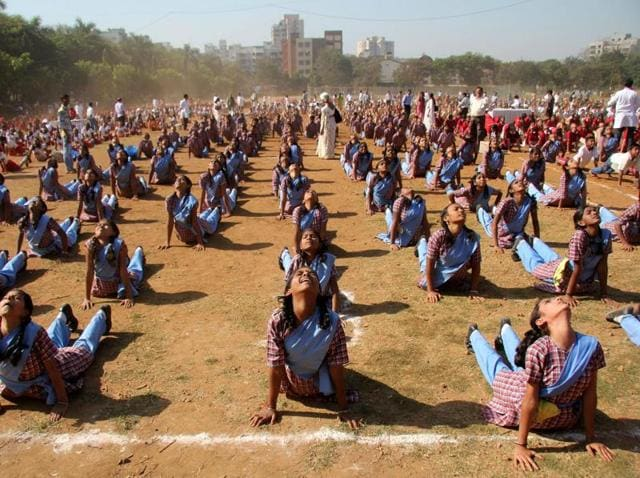 Mumbai February 18- More than 3000 students from 20 schools performed Suryanamaskar, a form of Yoga on the 150 th anniversary of Swami Vivekanand in Mulund Sambhaji ground, india ,2013 February 18-(Photo by Praful Gangurde)