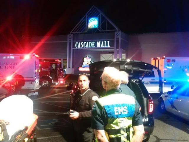 Medics wait to gain access to the Cascade Mall after four people were shot dead in Burlington, Washington, US.