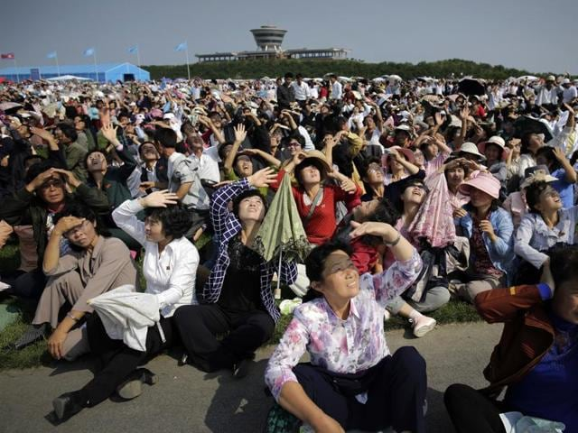 North Koreans watch an aerial display in Wonsan, North Korea on Saturday.