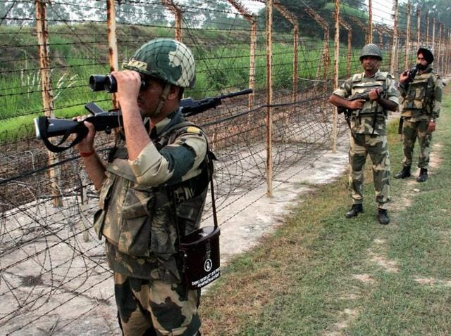 BSF personnel patrol along the India and Pakistan International Border at RS Pura, about 35 km from Jammu, on Saturday.