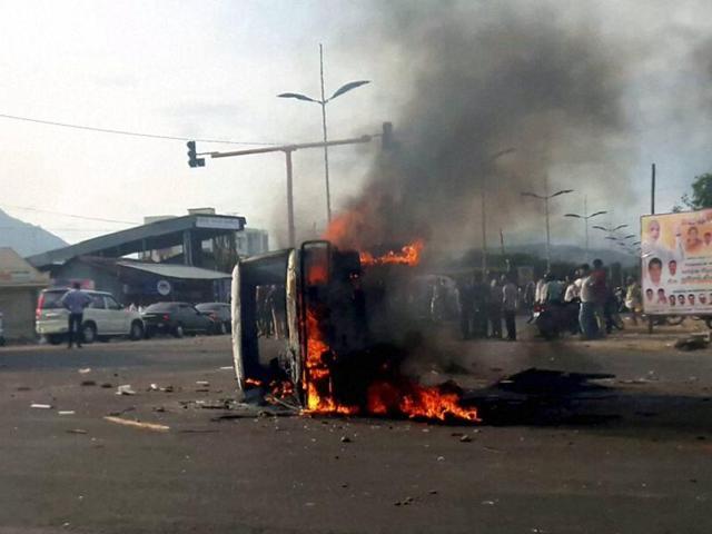 Police barricade against mobs protesting Hindu Munnani leader C Sasikumar's murder in Coimbatore on September 23, 2016.
