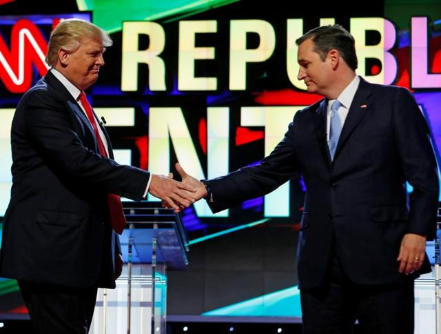 Donald Trump and Ted Cruz shake hands at the start of the Republican candidates debate sponsored by CNN at the University of Miami in Florida in March