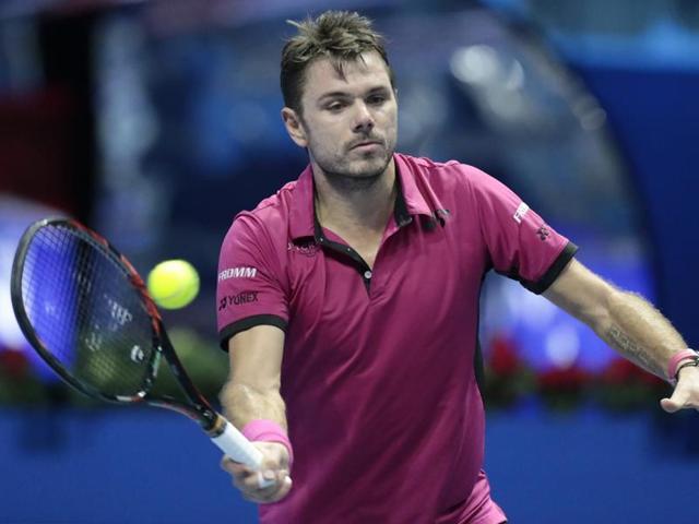 Stan Wawrinka of Switzerland returns the ball to Roberto Bautista of Spain during their St. Petersburg Open.