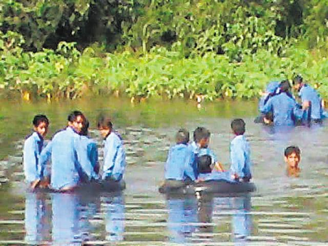 83 children  from Machet, Sevachin ka Pura and Madho Singh ka Pura villages of Karauli district put their lives to risk daily to go to school in absence of a bridge over the seasonal river.