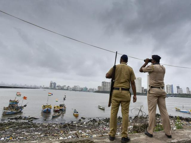 Police keep a lookout along the Mumbai coast in Colaba, after a high alert was issued on September 23, 2016.