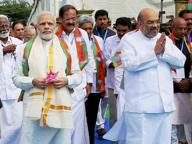Prime Minister Narendra Modi and BJP president Amit Shah in Kozhikode on Sunday.