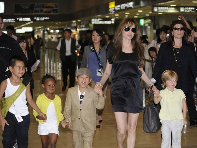 This file photo taken on July 26, 2010 shows US actor Angelina Jolie (2R), accompanied by her children Maddox (L), Zahara (2L), Pax (3L) and Shiloh (R), arriving at the Narita International Airport.