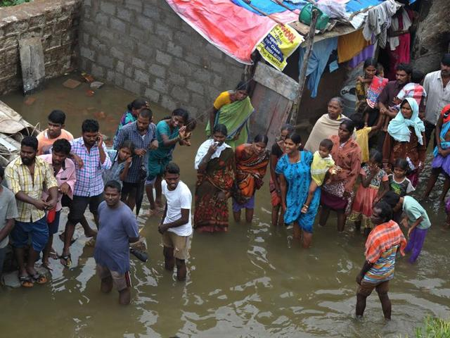 Residents stand in floodwater outside their homes following heavy rain in Alwal, on the outskirts of Hyderabad.