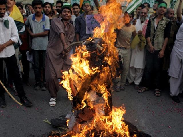 Supporters of the Pakistan Welfare Party burn an effigy of Prime Minister Narendra Modi during a demonstration  in Lahore, Pakistan.