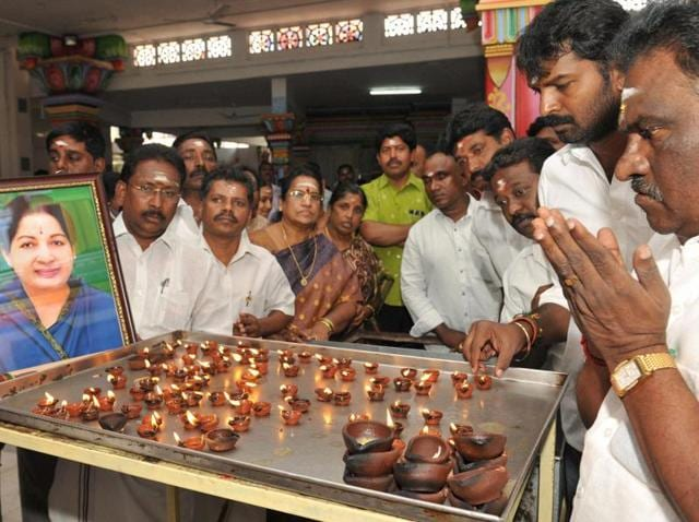 AIADMK MLA Amman Arjunan along with party members offers prayers at the Lord Murugan temple for the recovery of Tamil Nadu chief minister Jayalalithaa in Coimbatore.