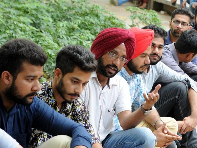 Students during a discussion on the upcoming Punjab assembly elections at the Punjabi University campus in Patiala on Saturday.