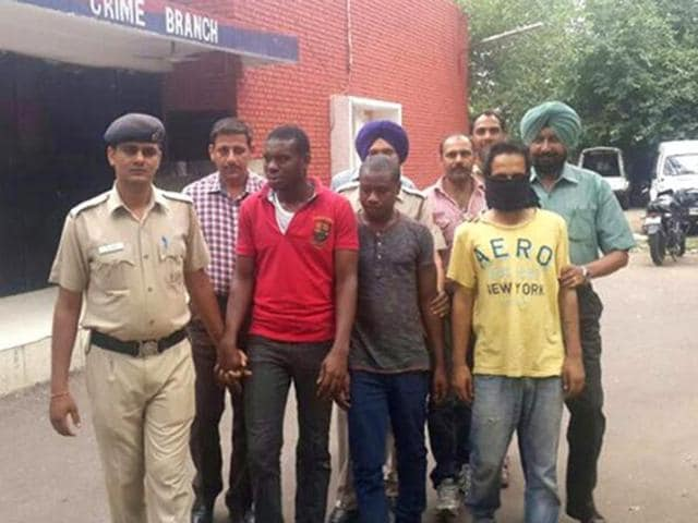 File picture of two Nigerians arrested with heroin near Patiala.