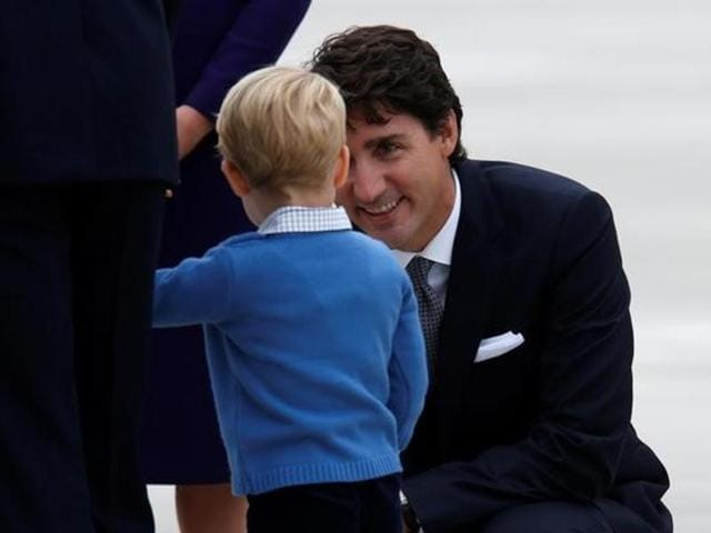 Canada's Prime Minister Justin Trudeau talks with Prince George at the Victoria International Airport  in British Columbia, Canada.