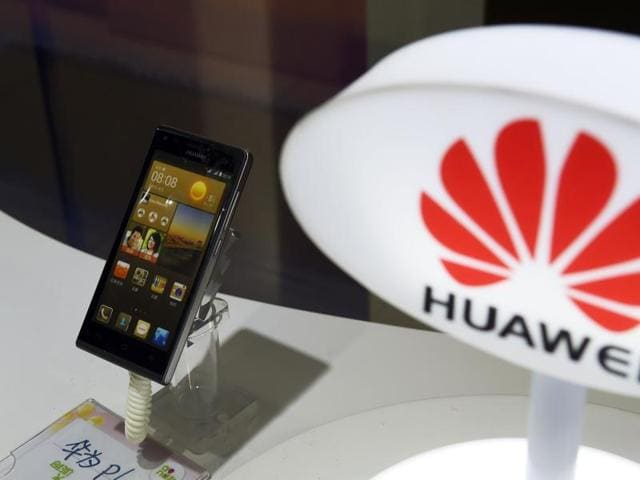 A mobile phone made by Chinese telecom equipment maker Huawei is displayed in a store in Beijing.
