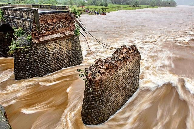 Two state transport buses and a private vehicle were swept away after the British-era bridge on the Savitri river collapsed on August 3, late in the night.(HT file photo)