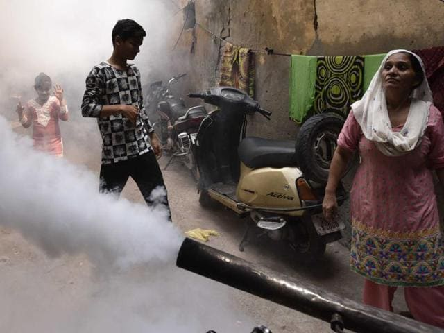 Municipal Corporation of Delhi (MCD) workers carrying out fumigation to curb the spread of dengue and chikungunya at Khureji in East Delhi.