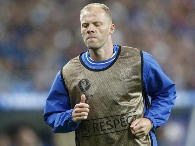 Iceland's Eidur Gudjohnsen warms up during the game.