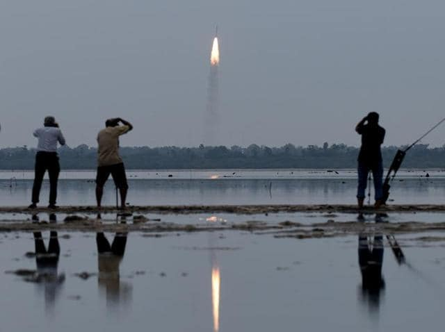 Residents photograph the launch of the Indian Space Research Organisation (ISRO)'s PSLV-C35.