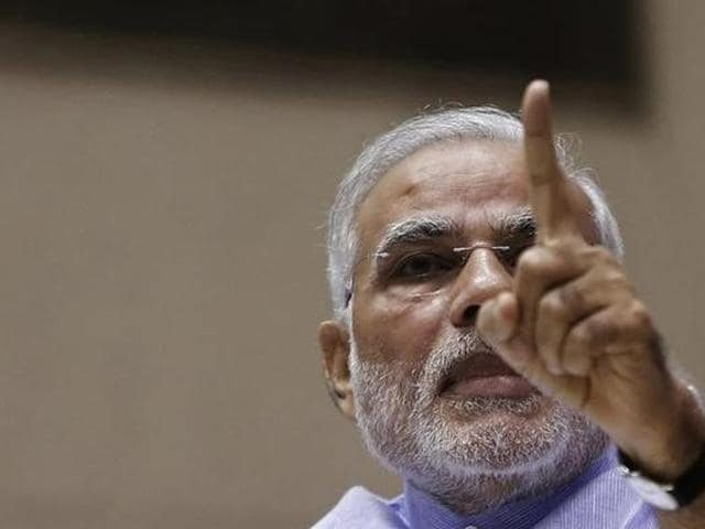 Prime Minister Narendra Modi attends the launch of the Jan Dhan Yojana in New Delhi in August.