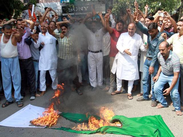 Shiv Sena activists burn Pakistan's flag during a protest against the Uri terror attack.