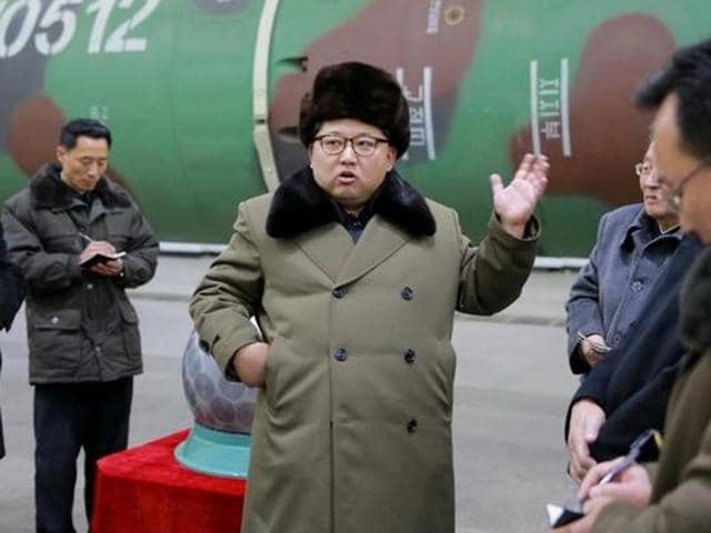 North Korean leader Kim Jong Un meets scientists and technicians researching on nuclear weapons in this undated photo released by North Korea's Korean Central News Agency (KCNA) in Pyongyang.