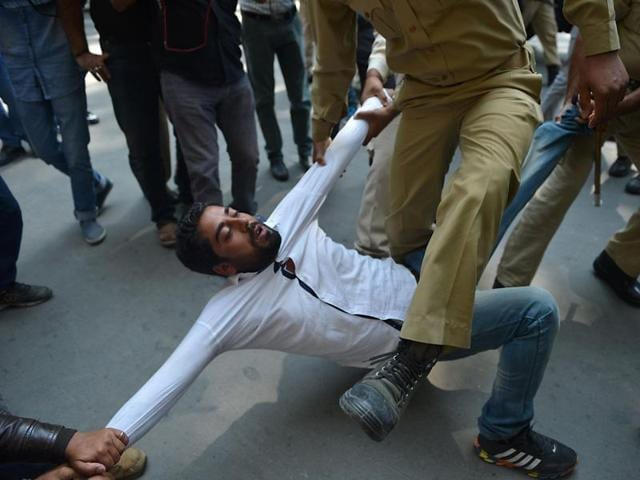 Police try to detain supporters of Jammu and Kashmir lawmaker Sheikh Engineer during a march towards the United Nations Military Observer Group of India and Pakistan.