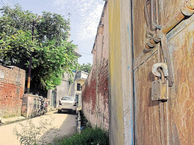 The locked house of a Muslim family that left Kutba.(Chahatram/ HT)