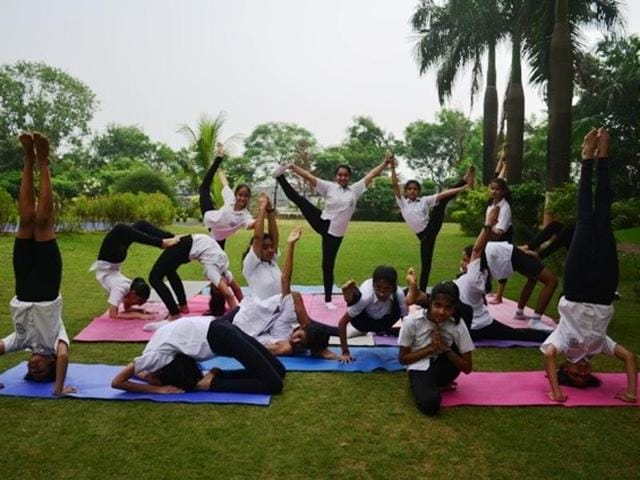 Students of Delhi Public School, Navi Mumbai, practise yoga.