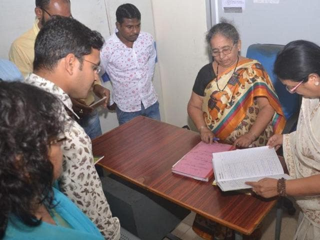 Indore mayor Malini Gaud inspects records at a zonal office on the first day of her ward scan on Monday.