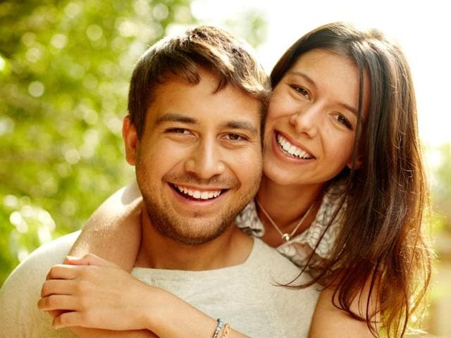 Simply having a happy partner may enhance your health as much as you striving to be happy, say researchers.