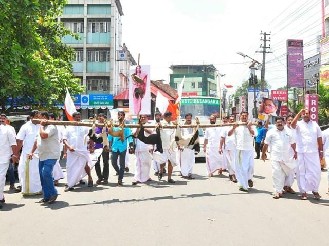 Youth Front (Mani) party workers killed 10 dogs and paraded their carcasses on the streets of Kottayam on Monday.(HT Photo)