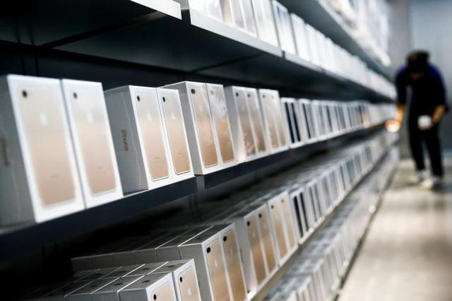 Apple's new iPhone 7 smartphones sit on a shelf at an Apple store in Beijing, China. Ahead of its launch in India, there has been a spurt in smuggling of iPhone 7 and 7s.