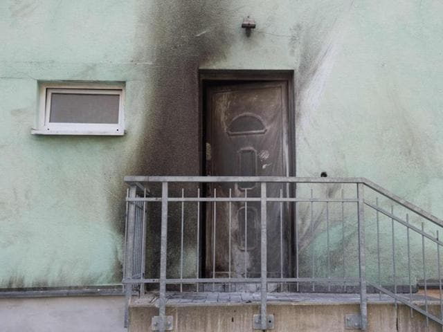 Traces of smoke can be seen after a bomb attack at the entrance to the Fatih Camii Mosque in Dresden, eastern Germany.